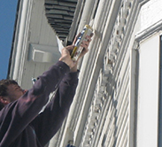 One of our experts providing exterior painting services in Minneapolis, MN